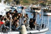 Migrants arriving on the island of Lampedusa.  The NATO-led invasion of Libya has opened a huge breach in Europe\