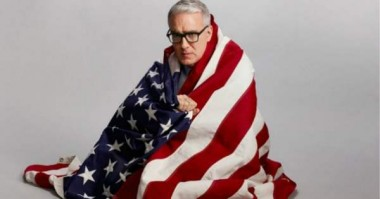 Technically, this is flag desecration--but Olbermann has hate America for years.