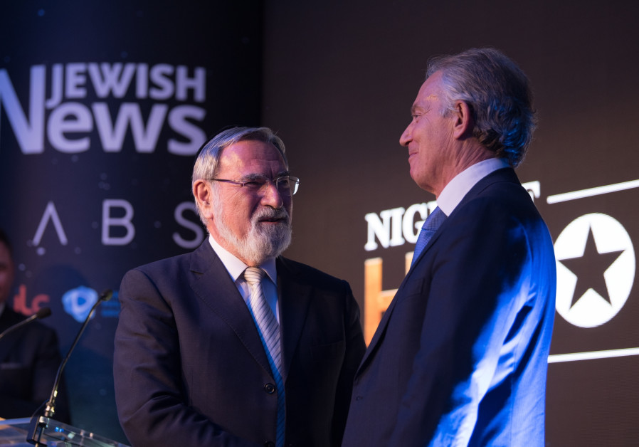 Jonathan Sacks is given an award by the war-criminal Tony Blair
