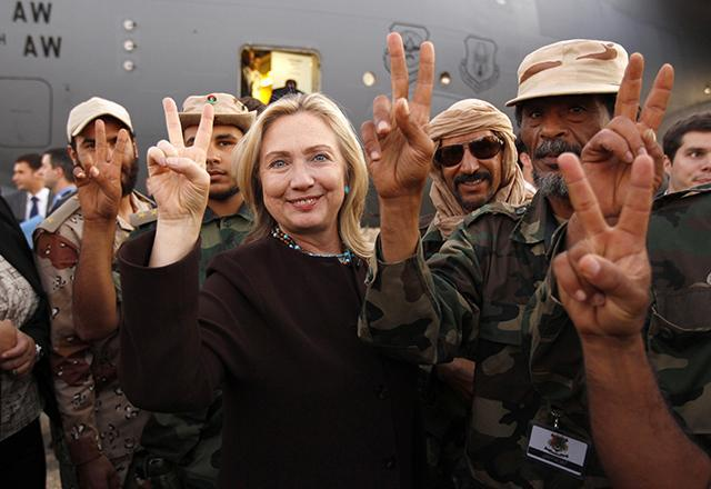 "Photo : Minn Post, ""Secretary of State Hillary Clinton with Libyan soldiers upon her departure from Tripoli in Libya on October 18, 2011"