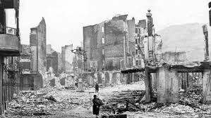 Guernica, after the visit of the Kondor Legion. For the historically challenged, this was the Spanish city bombed during the Spánish Civil War by the Germans in support of the Falangists.